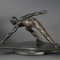 Bronze sculpture of a speed skater in mid turn