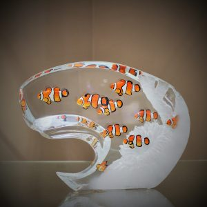 Glass sculpture of clownfish in seascape