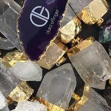 Dara Ettinger crystal jewelry and logo